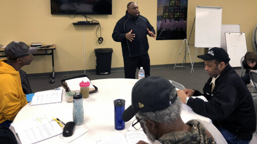 Pastor Bracy leads study during a Men's Ministry breakfast.